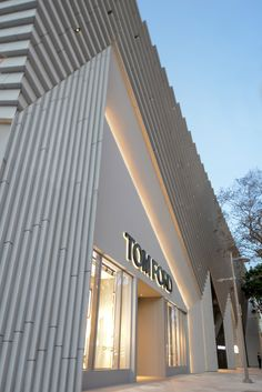 Angular concrete facade by Aranda\Lasch for fashion designer Tom Ford's Miami flagship store.