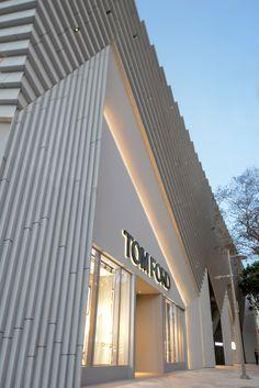 Angular concrete facade by Aranda\Lasch for fashion designer Tom Ford's Miami flagship store.
