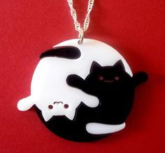 Awesome! Yin & yang. Perfect for the crazy cat lady in your life who haw everything. ;)