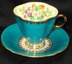 ROYAL WINDSOR ENGLAND GOLD BRAMBLE BERRY BLUE TEA CUP AND SAUCER by yvette