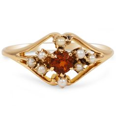 10K Yellow Gold The Margret Ring from Brilliant Earth This beautifully delicate Victorian ring features a unique orange zircon center surrounded by eight cultured seed pearls in a floral design (Zircon approx. 0.35 total carat weight).
