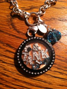 My locket I made for my dog who I have lost.. Just an idea.. www.suedelong.origamiowl.com