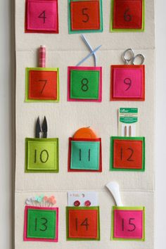 Felt Advent Calendar... looks super easy. Just cut squares and sew. There are other ways to get the numbers on there if you don't want to embroider. Looks like it folds up nicely too.