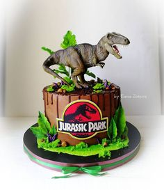 Order Jurassic Park Designer Chocolate Cake online for delivery in uae. Send Jurassic Park Designer Chocolate Cake to your loved ones with Ferns N Petals. Dinosaur Cakes For Boys, Dinosaur Birthday Cakes, 3rd Birthday Cakes, Dinosaur Dinosaur, Jurassic Park Party, Jurassic World Cake, Jurrasic Park Cake, Bolo Dino, Dinasour Birthday