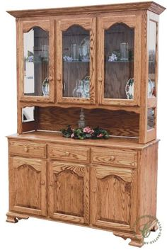 Our LaGrange 3-Door Open Hutch boasts a scrolling apron, bracket feet, cathedral arch doors, and a crown moulding to be heirloom worthy in your family.