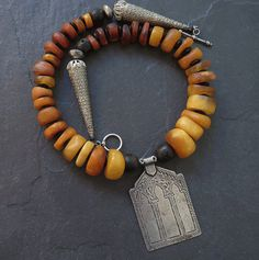 Moroccan Fossil Amber and Black Coral Necklace with Antique Berber Silver Pendant