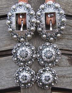Diamond B Jewelry - Custom Made Buckle Sets  Antique Black Diamond Custom Made Buckle sets! 2 Buckles & 4 Conchos, Bright or Antique with Genuine Swarovski Crystals. Prices start at $55 for a single color set. Your Custom Made set can be as simple or elaborate as you want. Matching saddle sets and jewelry can also be made.  Check out my facebook page Diamond B Jewelry or my website www.diamondbjewelry.com    I will be happy to ship to you, $5.50 priority mail, paypal accepted :)  $65.00