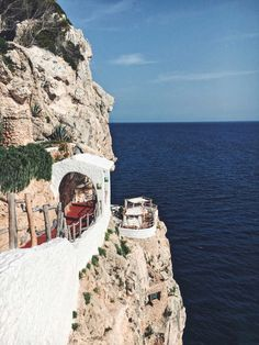 <p>If you find yourself on the southern side of the beautiful island of Menorca – the little sister to Mallorca in Spain, chances are the locals will tell you about Cova d'en Xoroi. Find it near the resort town of Cala en Porter and perched high up on rocky cliffs above crystal clear waters. This…</p>