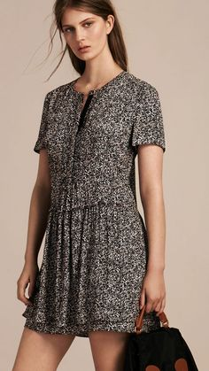 A floral print Burberry shift dress in lightweight silk georgette. Feminine and effortless, it is cut with a dropped waist and a gathered double-layered skirt.