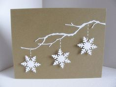 handmade greeting card ... Schneeflocke ... kraft base with white die cut cuts ... delicate tree branch with three snowflake ornaments hanging down ...
