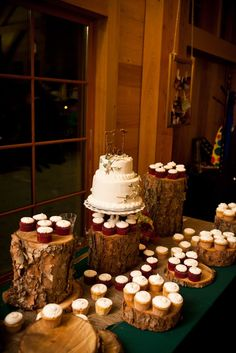 Possibly a tiered dessert table using logs? Decorate with branches and leaves.