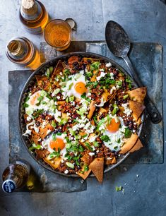 Chilaquiles Recipe with Eggs and Feta Check out this punchy chilaquiles dish with easy baked eggs. Roasting the tortilla chips in this recipe makes them super crisp and crunchy, so grab a spoon and tuck in