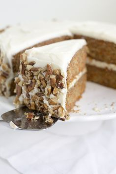 The very best recipe for homestyle carrot cake layered with cream cheese frosting and finished with lots of chopped pecans. Perfect for Easter!