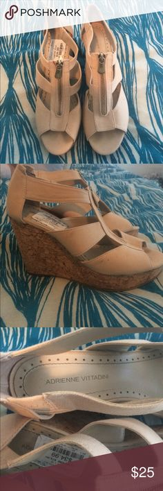 EUC Adrienne Vittadini size 8 cream cork wedges! EUC cream size 8 Designer cork wedges, used for a photoshoot and forgot to take off the tag. Light toe pattern at front of shoe from wearing that one time and light damage to the bottoms. In perfect condition otherwise, feel free to make an offer Adrienne Vittadini Shoes Wedges