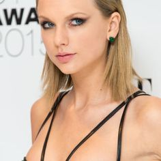 Taylor Swift has never looked so badass. This sleek bob is the combination of a couple things: sheared, pointed ends slicked back behind the ears and a deep side part with a gelled-back fringe.