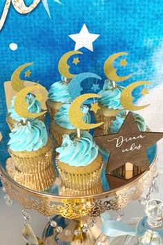 Take a look at this sparkly Twinkle Twinkle Little Star Baby Shower! The cupcakes are goregous! See more party ideas and share yours at CatchMyParty.com #catchmyparty #partyideas #twinkletwinklelittlestar #babyshower #boybabyshower #cupcakes