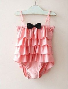• Available for 2-7 year old girls  • Made of 80% nylon, 20% spandex.  • Machine wash.  • Treated for excellent UV protection  • Sweetheart black bow detail  • Tiered-tulle ruffles at skirted bottom  • Smooth, quick drying nylon shell  • Stylish Hat included      MONEY BACK WARRANTY  In case you ...