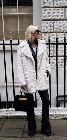 Celine Aagaard is wearing a white faux fur coat from TopShop | Street Style fashion