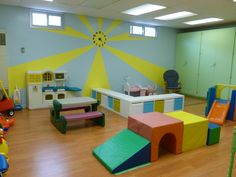 Church Nursery reno - giant sunburst clock, new laminate floors, Ikea expedit storage systems, bright paints