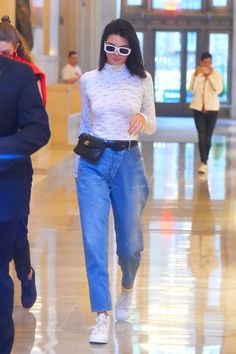 """Kendall Jenner in an Eckhaus Lattta turtleneck, mom jeans, white sneakers and Chanel fannypack - click through to see more of her """"mom"""" outfits"""