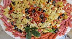 Tortellini Salad with Artichoke Hearts, Dried Tomato, Olives and Fresh Mozzerella. Platter with deli meats.