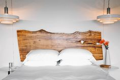 Saw legs off coffee table = awesome headboard. 11 Decor Picks To Make Over Your Home #refinery29