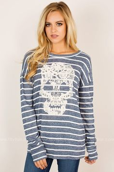 This trendy long sleeve striped top features a crocheted lace skull to add an edgy feel to your fall look!