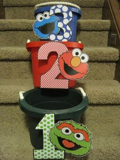 Elmo beanbag toss game brought to you by the numbers 1, 2 and 3. See more Elmo birthday party ideas at www.one-stop-party-ideas.com