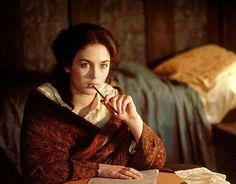 """Lovely picture of Isabelle Adjani from """"The Story of Adele H,"""" a French film from 1975.  It takes place a bit too early (1863) but I love the look of this determined young Victorian woman writing and thinking at night."""