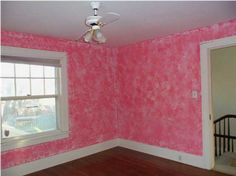 pink room with ceiling fan.