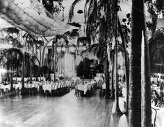 1922 Interior view of the Ambassador Hotel's Cocoanut Grove in 1922. Notice BALLOONS in net ready to be dropped! Later the 1934 version was designed by Mary Jeffras. It was once Los Angeles' most exclusive night spot. Although it was renovated in 1957, the club never recovered the reputation it enjoyed in its early days.