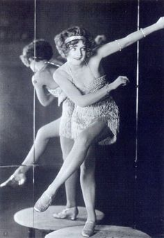 """Bee Jackson, 1920s  From the book: """"World champion Charleston dancer Bee Jackson wears a beaded and fringed dance dress, popular at the time, as the fringes would shimmer and shake and draw attention to movement. This dress is shorter than the typical styles of the era. Paste jewellery known as """"slave bracelets"""" was often worn high up on the arm as well as the wrist.""""  Scanned from """"Decades of Fashion"""" by Harriet Worsley."""