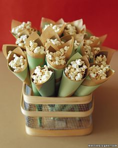 Popcorn cones: regular popcorn or that pretty old-fashioned pink popcorn... or some of each! From martha stewart weddings #popcorncones #popcorn #weddingfavors