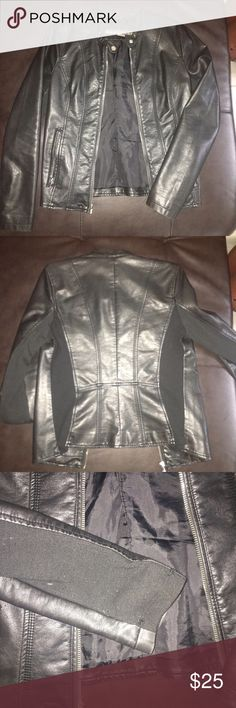 Black Leather Jacket Cool black leather jacket with zipper pockets. The jacket is very fitting to the body and frames the body well. Very comfortable. On the sleeves there is a black stretchy material that has worn down a little, this is shown in picture 3. In good condition. Kenneth Cole Reaction Jackets & Coats