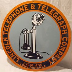 Round sign for Lincoln Telephone & Telegraph Company showing a vintage telephone in the center.