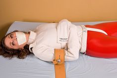 Woman experiences strapped to bed in a straitjacket and tape gagged isn't that childish that she thought before.