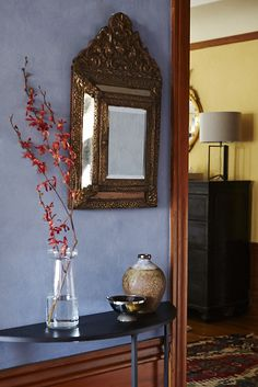 Entry: The Ralph Lauren Suede paint walls in Vista Blue was inspired by Moroccan plaster.