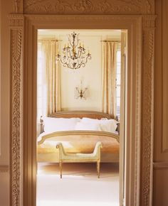 This boudoir is completelypeaceful and elegant. With intricate moldings, glistening crystal lighting, crisp white sheets and earth tone colours