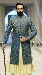 Pakistan's most anticipated bridal show, Telenor Bridal Couture Week (TBCW) began with glitz and glamour here at the Faletti's Hotel, Lahore. Blue Sherwani, Sherwani Groom, Mens Sherwani, Wedding Sherwani, Punjabi Wedding, Wedding Dresses Men Indian, Wedding Dress Men, Wedding Men, Wedding Suits