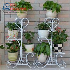 Ucuz Avrupa demir yaratıcı raf katı ahşap katmanlı yeşil Chlorophytum kapalı kat çiçek standı ÜCRETSIZ NAKLIYE, Satın Kalite bahçe süsleri doğrudan Çin Tedarikçilerden: Avrupa demir yaratıcı raf katı ahşap katmanlı yeşil Chlorophytum kapalı kat çiçek standı ÜCRETSIZ NAKLIYE