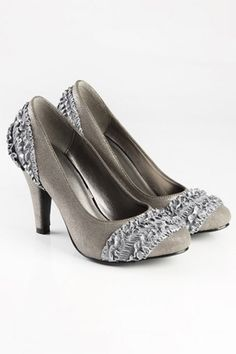 Court shoes crafted in PU, featuring a low cut vamp, pointed toe, ruffled silk detail to front vamp and back counter, stitching to the main with a rubber sole and a high heel.$55