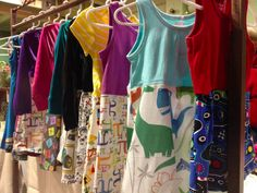 Their clothing line is called Princess Awesome and features colourful dresses with designs such as dinosaurs, maths symbols, pirates, classic art, and ninjas. | These Parents Couldn't Find Their Daughters Dresses With Trucks And Dinosaurs On So They Designed Their Own