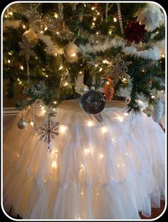 Christmas tree skirt using white lights, white tablecloth/fabric and wedding dress petticoat - so feminine and bright.