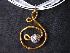 Tangerine orange curly wire pendant by KatKeRosCorner on Etsy, $20.00