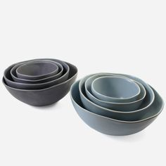"""These ceramic nesting bowls, with their gently undulating rims, are perfectly imperfect. Fill them with an assortment of nuts and olives for your next dinner party, or simply display them one inside the other and admire their sculptural beauty. This set of bowls makes a great gift for pottery aficionados and entertainers alike. The smallest bowl measures approximately 4"""" in diameter and 2"""" high, the bowl it fits in is 5"""" in diameter and 2.25"""" high, the next bowl ..."""