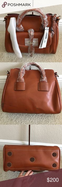 """Dooney&Bourke Florentine Tosacana Small Front Dooney & Bourke Florentine Tosacana Small Front Pocket Satchel. New with defect. Has some black marks and scratches. On the bottom back and some cigarette burns wears. In great condition other then that. Measures approximately 11-1/2""""W x 9-1/2""""H x 5-3/4""""D with a 2"""" handle drop and a 17"""" to 26"""" strap drop; weighs approximately 2 lbs, 3 oz Body/trim/lining 100% leather; pockets 100% nylon Dooney & Bourke Bags Crossbody Bags"""