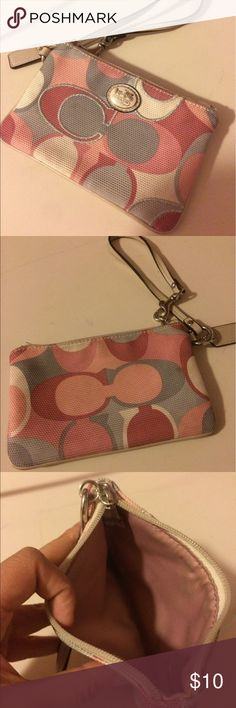 Coach Pink Wristlet Wallet Coach Wristlet! It's in okay condition but does show wears. The inside and outside of the Wristlet has dis coloring due to being used a lot. It's still in good condition to be used! Coach Bags Clutches & Wristlets