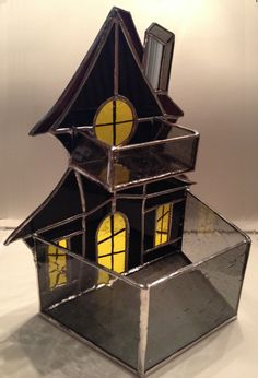 Etsy の Handmade Stained Glass Haunted House Candle Holder by QTSG
