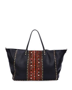 THIS BAG IS EVERYTHING. Large+Painted+Rockstud+Tote+Bag,+Black+by+Valentino+at+Neiman+Marcus.