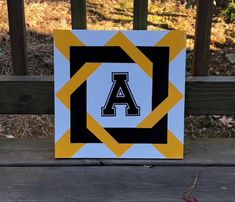 black and gold wrapped ASU star Barn Quilt Designs, Quilting Designs, Barn Quilts For Sale, Amish Quilt Patterns, Bird Quilt Blocks, Painted Barn Quilts, Barn Signs, Custom Quilts, Rustic Barn